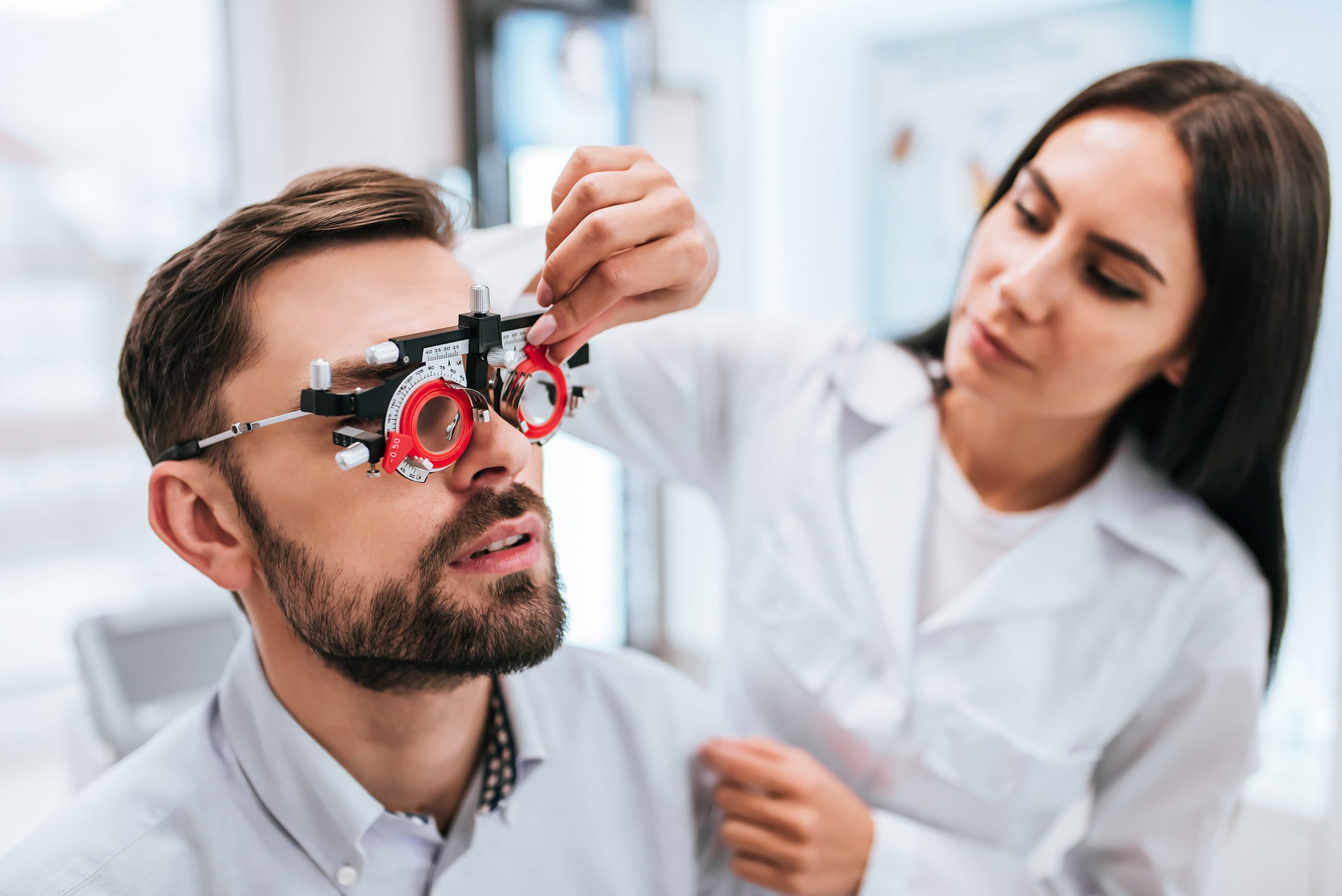 Man has his vision tested by female doctor